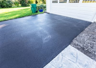freshly laid black concrete home driveway at melton concreters